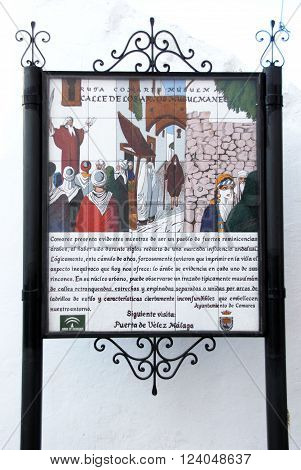 COMARES, SPAIN - JUNE 29, 2008 - Comares Muslim trail ceramic sign depicting a sermon along the Calle de los arcos Musulman Comares Malaga Province Andalusia Spain Western Europe, June 29, 2008.