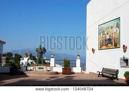Balcony with statue of Antonio Miguel Gallego Romero and ceramic picture on wall depicting flamenco dancing Comares Malaga Province Andalusia Spain Western Europe.