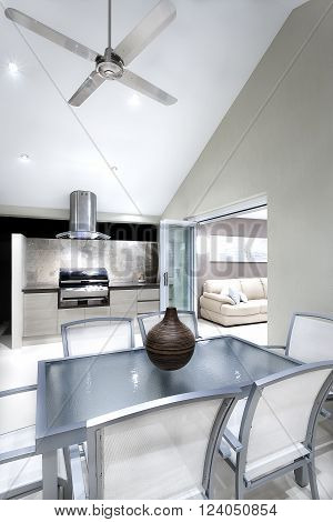 Modern Dining Area With Chairs And Glass Tables