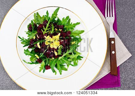 Dietary food without meat: Salad with arugula and beet. Studio Photo