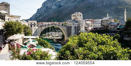 Mostar, Bosnia-Hercegovina - September 14, 2015: Tourist at the old bridge of Mostar which was destroyed in the war and rebuild in 2004. It is a tradition for men to dive off bridge.
