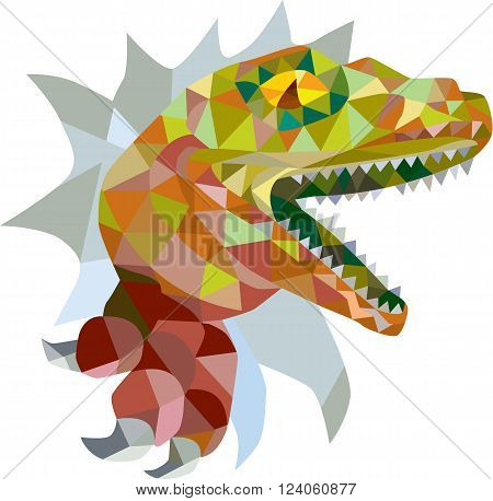 Low polygon style illustration of a raptor t-rex dinosaur lizard reptile breaking out of wall on isolated background.