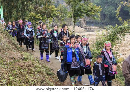 Sapa Vietnam - February 16 2016: Aboriginal people of the mountains of Sapa in north Vietnam dressed with their traditional attire and walking in their village