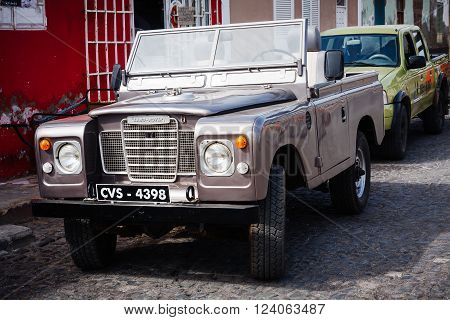 SANTA MARIA, CAPE VERDE - DECEMBER 16, 2015: Old Land Rover Series 3 polished silver cabrio. Vintage four wheel drive car