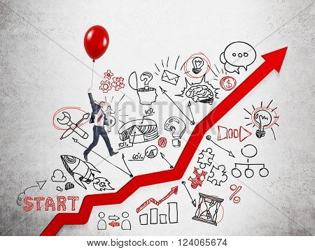Businessman flying on red balloon over red graph drawn on concrete wall many business icons around. Concept of career growth.