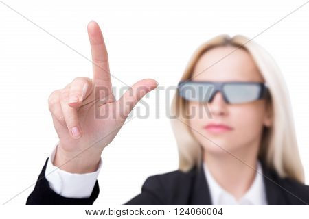 Businesswoman in 3D glasses touching invisible screen. Isolated. Concept of 3D glasses.