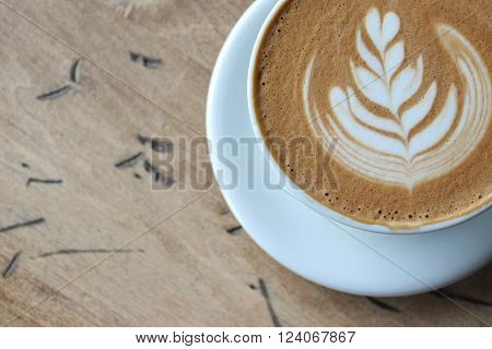 Over head view of a latte with latte cream art with room for copy