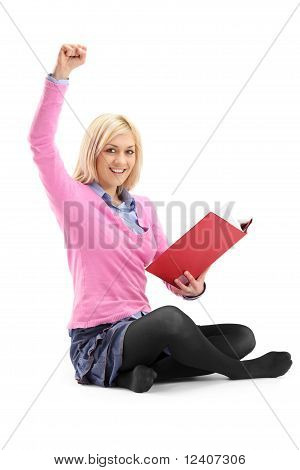 A Happy Female Student Reading A Book