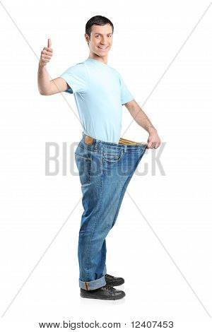 Full Length Portrait Of A Weight Loss Male With Thumb Up