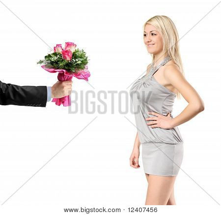 Hand Giving A Bunch Of Flowers To A Sexy Woman