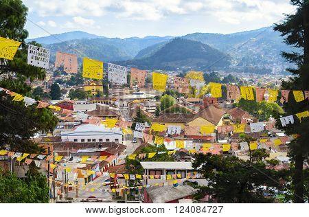 Aerial view to San Cristobal de las Casas with numerous religious flags