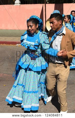 SAN CRISTOBAL DE LAS CASAS MEXICO 13 DECEMBER 2015: Couple in traditional dress from Durango state dancing outdoors