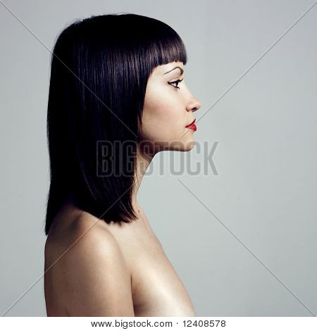 Fashion photo. Profile of woman with strict hairstyle