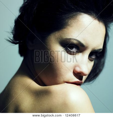 Fashion portrait of sensual woman with predatory sight