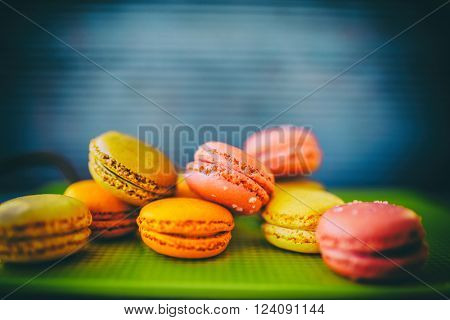 Macaroons - colored almond cookies with different flavors, French delights (filtered)