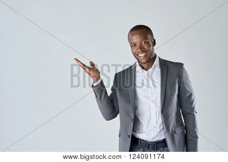 Charming handsome young black business man holding his hand up to show present sell product