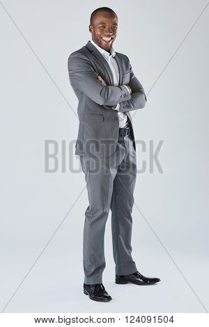 Full length portrait of positive friendly black  professional businessman in business suit isolated in studio