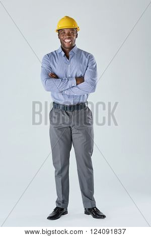 Black african business man architect construction manager in formal attire and yellow hardhat
