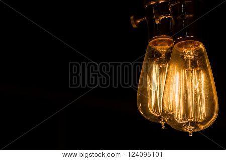 Vintage Edison Light Bulbs hanging against a black  background