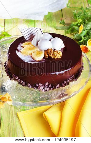 glazed chocolate cake with banana and walnuts, whole, still life, close-up of a beautiful, spring, food, atmosphere, decor, pansies, Cake Stands