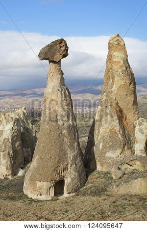 Ancient dwelling in the cone of rock-fungus. Cappadocia, Turkey