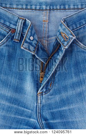 Denim jeans texture or denim jeans background with zipper. Old grunge vintage denim jeans. Stitched texture denim jeans background of jeans fashion design.