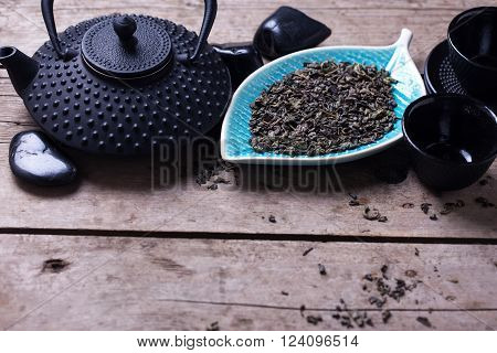 Traditional asian tea set on aged wooden background. Selective focus. Place for text.
