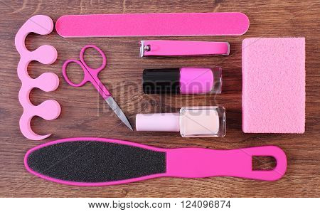Cosmetics and accessories for manicure or pedicure, nail file, scraper, pumice, nail polish, scissors, nail clippers, pedicure separator, concept of nail, hand and foot care