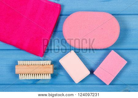 Cosmetics and accessories for personal hygiene in bathroom, soap, towel, sponge, brush, pumice, concept of body care