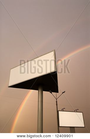 Two blank billboards under double rainbow