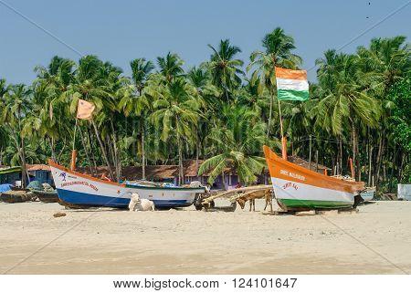 Papolem, Inida - January 3,2012:Fisherman boat on the tropical beach at Palolem beach in Goa, India
