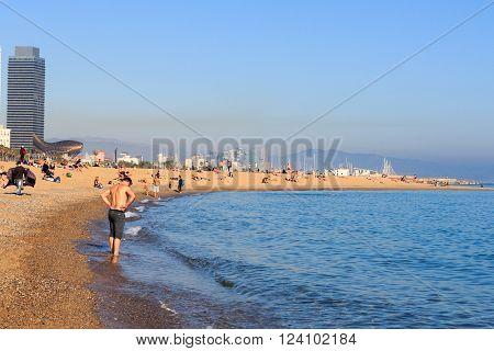 Barcelona, Spain - November 11, 2015: Beach in Barceloneta and Mediterranean Sea. La Barceloneta is a neighborhood in the Ciutat Vella district of Barcelona. It is known for its sandy beach.