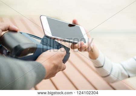 Woman pay by NFC on mobile phone