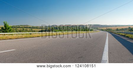 Morning landscape with high-way near Novomoskovsk city in central Ukraine