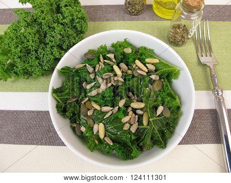 Kale salad with sunflower seeds, pine nuts, pumpkin seeds