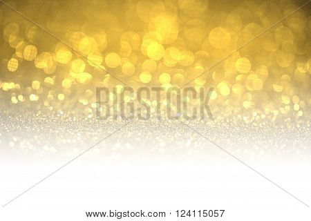 Gold glitter surface with gold light bokeh with white copyspace - It can be used for background for special occasions promotion campaign or product display