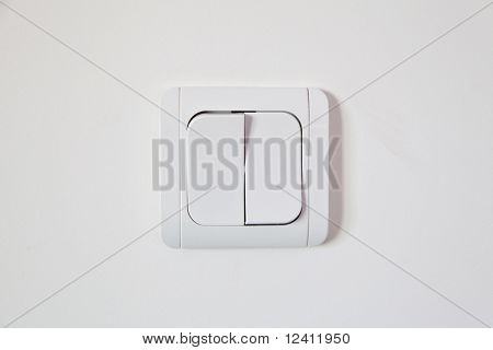 white light switch on white wall