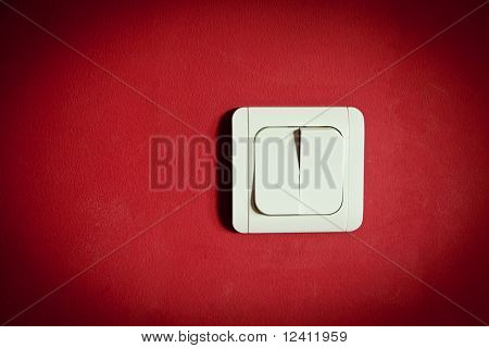 white light switch on red wall