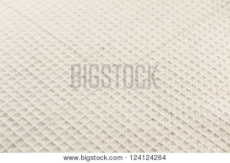 Grunge beige waffle weave fabric as a background