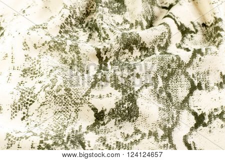 crumpled beige fabric with pattern as background