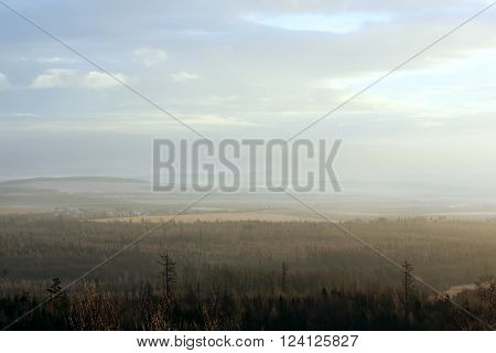 Sunrise misty country scenery. View on foothills of Tatra Mountains in Slovakia.