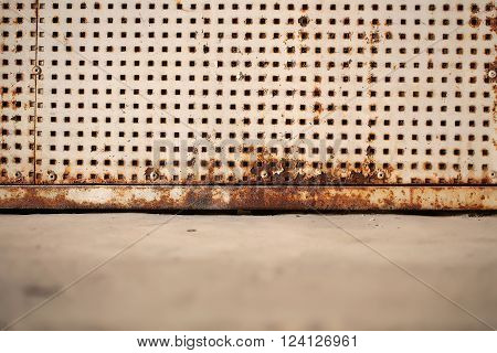 Rusty Plate With Square Holes