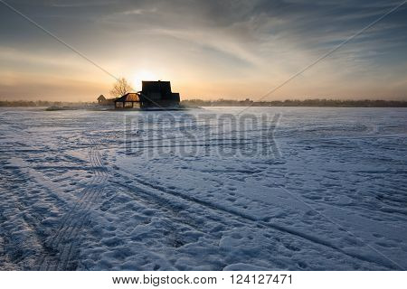 Sunset in the winter on the frozen lake