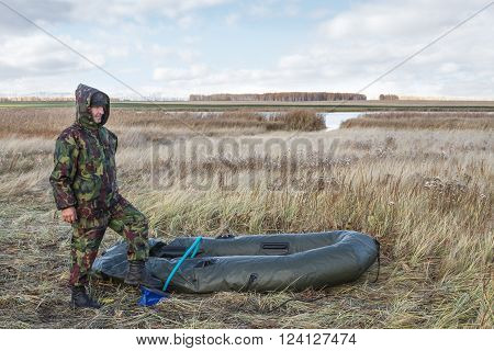 Hunter pumps up an inflatable boat .