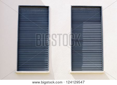 Windows of a house closed with shutters.
