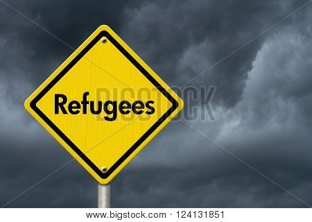 Refugees Road Sign Yellow Caution sign with word Refugees with stormy sky background