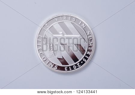 Saransk, Russia - April 2, 2016: Silver-plated Litecoin on a white background.