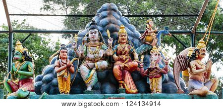 Hindu temple entrance depicting Lord Shiva and his family as seated on Mount Kailash