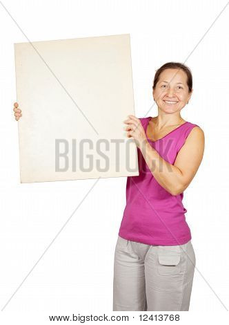 Mature Woman  Holds  Placard