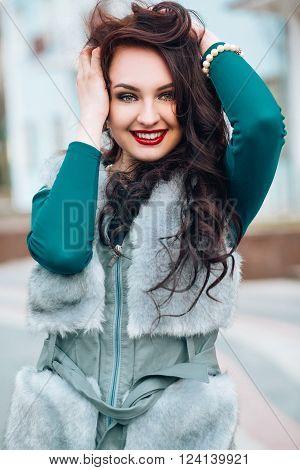 Beauty Fashion Model Girl in Fox Fur Coat. Beautiful Woman in Luxury Fur Jacket